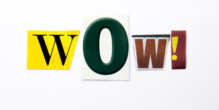 A word writing text showing concept of Wow made of different magazine newspaper letter for Business case on the white background with space Stock Photo