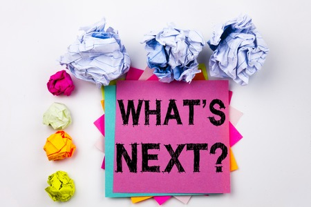 Writing text showing Question Whats Next written on sticky note in office with screw paper balls. Stock Photo