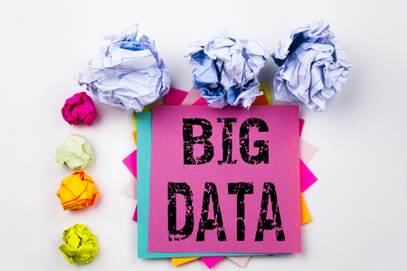Writing text showing Big Data written on sticky note in office with screw paper balls. Business concept for Storage Network Online Server on the white background. Stock Photo