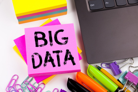 Writing text showing Big Data made in the office with surroundings such as laptop, marker, pen. Business concept for Storage Network Online Server Workshop white background with space Stock Photo