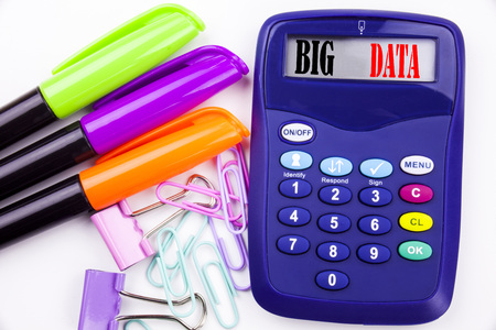 Writing word Big Data text in the office with surroundings such as marker, pen writing on calculator. Business concept for Storage Network Online Server white background with space