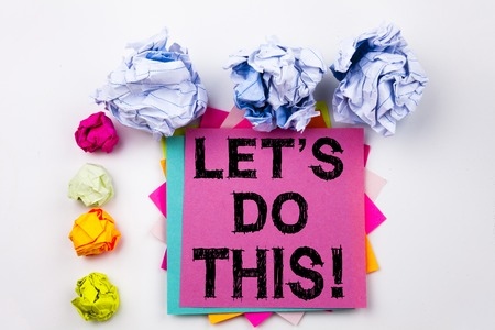 Writing text showing Human Trafficking written on sticky note in office with screw paper balls. Business concept for Encouragement Initiate Saying on white isolated background. Stock Photo