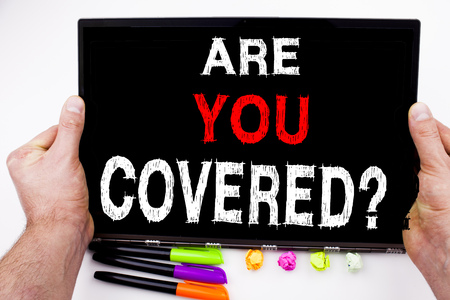 Question Are you Covered text written on tablet, computer in the office with marker, pen, stationery. Business concept for Travel Insurance Healthcare Safety white background with copy space Stock Photo