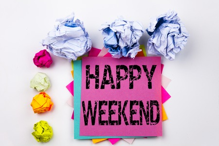 Writing text showing Happy Weekend written on sticky note in office with screw paper balls. Business concept for Holiday Day Off Celebration on white isolated background. Stock Photo