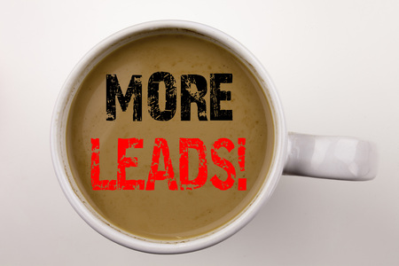 Word, writing More Leads text in coffee in cup. Business concept for Get More Leads Consumer Marketing on white background with space.
