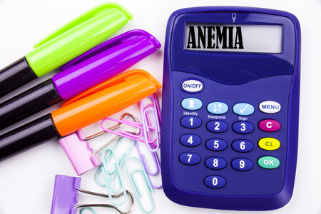 Writing word Anemia text in the office with surroundings such as marker, pen writing on calculator. Business concept for Medical Diagnosis Iron deficiency aplastic white background with space