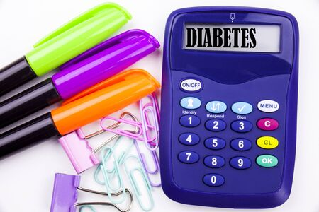 Writing word Diabetes text in the office with surroundings such as marker, pen writing on calculator. Business concept for Disease Medical Insulin white background with space