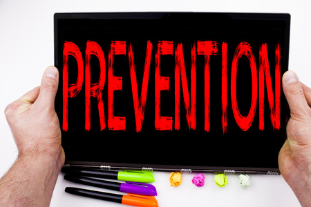Prevention text written on tablet, computer in the office with marker, pen, stationery. Business concept for Business Medical health illness disease white background with space
