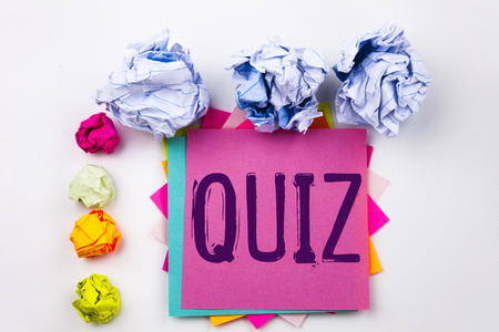 Writing text showing Quiz written on sticky note in office with screw paper balls. Business concept for Test education Exam Concept the white isolated background.