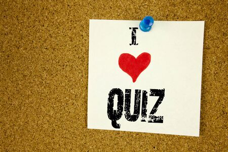 Hand writing text caption inspiration showing I Love Quiz concept meaning Test education Exam Concept Loving written on sticky note, reminder isolated background with space