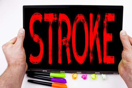 Stroke text written on tablet, computer in the office with marker, pen, stationery. Business concept for Medicine health stethoscope illness white background with space