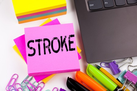 Writing text showing Stroke made in the office with surroundings such as laptop, marker, pen. Business concept for Medicine health stethoscope illness Workshop white background space