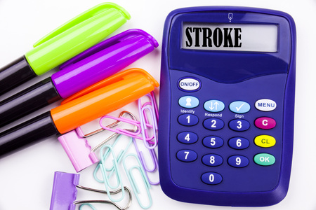 Writing word Stroke text in the office with surroundings such as marker, pen writing on calculator. Business concept Medicine health stethoscope illness white background with copy space