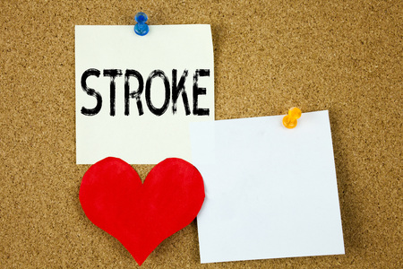 Conceptual hand writing text caption inspiration showing Stroke concept for Medicine health stethoscope illness and Love written on sticky note, reminder cork background with space Фото со стока