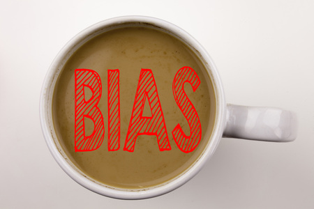 Word, writing Bias text in coffee in cup. Business concept for Prejudice Biased Unfair Treatment on white background with . Black text with red word.