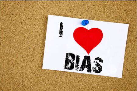 Hand writing text caption inspiration showing I Love Bias concept meaning Prejudice Biased Unfair Treatment Loving written on sticky note, reminder isolated background with space Stock Photo