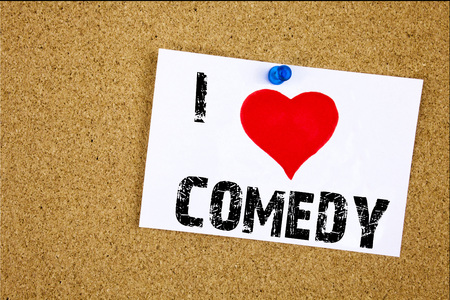 Hand writing text caption inspiration showing I Love Comedy concept meaning Stand Up Comedy Microphone Loving written on sticky note, reminder isolated background with space