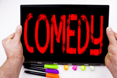 Comedy text written on tablet, computer in the office with marker, pen, stationery. Business concept for Stand Up Comedy Microphone white background with space