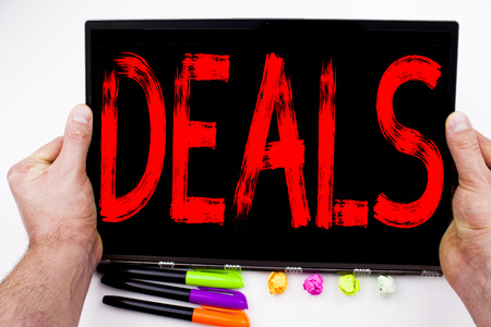 Deals text written on tablet, computer in the office with marker, pen, stationery. Business concept for Advertising Deal white background with space Stock Photo