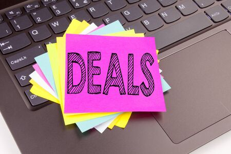 Writing Deals text made in the office close-up on laptop computer keyboard. Business concept for Advertising Deal Workshop on the black background with space Stock Photo
