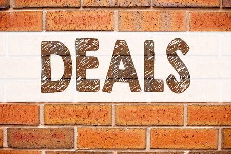 Conceptual announcement text caption inspiration showing Deals. Business concept for Advertising Deal written on old brick background with space Stock Photo