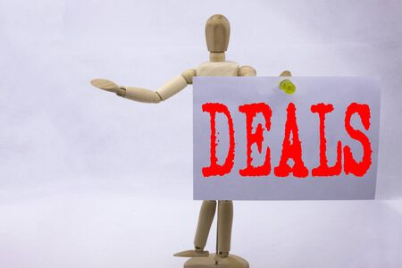 Conceptual hand writing text caption inspiration showing Deals Business concept for Advertising Deal written on sticky note sculpture background