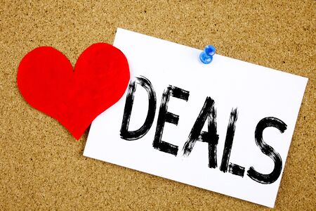 Conceptual hand writing text caption inspiration showing Deals concept for Advertising Deal and Love written on sticky note, reminder cork background with space Stock Photo