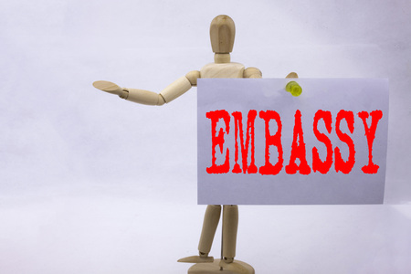 Conceptual hand writing text caption inspiration showing Embassy Business concept for Tourist Visa Application written on sticky note sculpture background