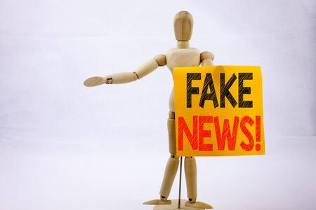 Conceptual hand writing text caption inspiration showing Fake News Business concept for Propaganda Newspaper Fake News written sticky note sculpture background with space Stock Photo