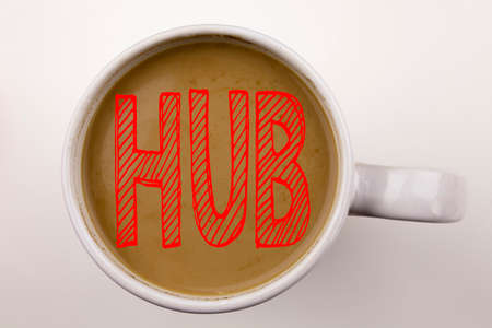 Word, writing HUB text in coffee in cup. Business concept for HUB Advertisement on white background with space. Black text with red word. Stock Photo