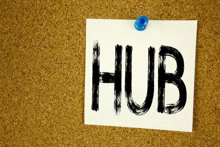Conceptual hand writing text caption inspiration showing HUB. Business concept for HUB Advertisement written on sticky note, reminder cork background with space