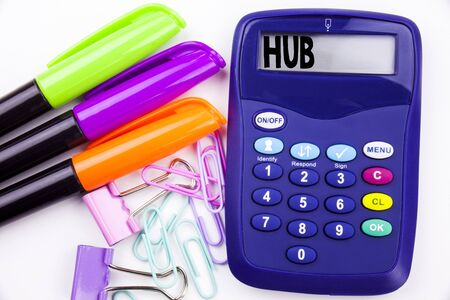 Writing word HUB text in the office with surroundings such as marker, pen writing on calculator. Business concept for HUB Advertisement white background with space Stock Photo