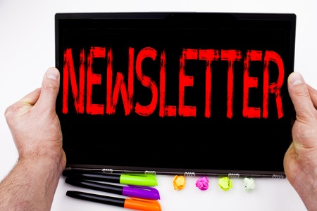 Subscribe Newsletter text written on tablet, computer in the office with marker, pen, stationery. Business concept for Internet Online Communication white background with space