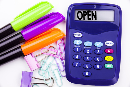 Writing word Open text in the office with surroundings such as marker, pen writing on calculator. Business concept for shop Opening white background with space