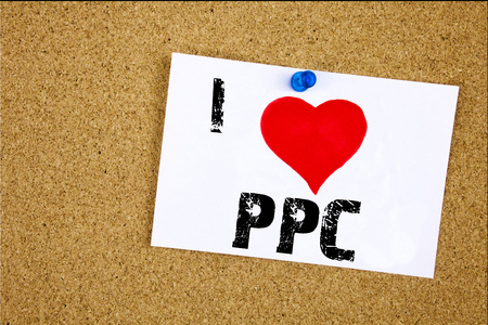Hand writing text caption inspiration showing I Love PPC - Pay per Click concept meaning Internet SEO Money Loving written on sticky note, reminder isolated background with space Stock Photo