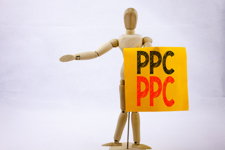 Conceptual hand writing text caption inspiration showing PPC - Pay per Click Business concept for Internet SEO Money written on sticky note sculpture background