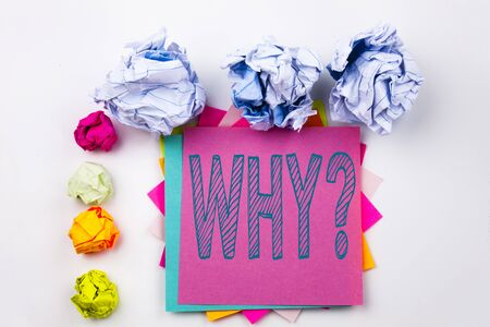 Writing text showing Why question written on sticky note in office with screw paper balls. Business concept for Asking Concept on white isolated background.