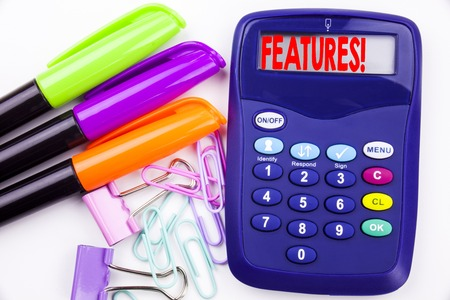 Writing word Features text in the office with surroundings such as marker, pen writing on calculator. Business concept for Advertisement Advertising white background with space Stock Photo