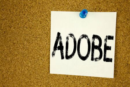 Conceptual hand writing text caption inspiration showing ADOBE. Business concept for  Software Company Name written on sticky note, reminder cork background with space