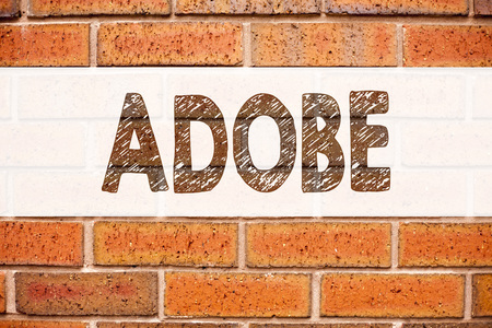 Conceptual announcement text caption inspiration showing ADOBE. Business concept for Software Company Name written on old brick background with space