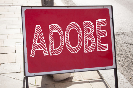 Hand writing text caption inspiration showing ADOBE concept meaning Software Company Name written on old announcement road sign with background and space