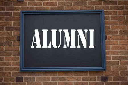 Conceptual hand writing text caption inspiration showing announcement Alumni Former Students. Business concept for  Celebration Education Ending written on frame old brick background with space