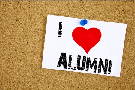 Hand writing text caption inspiration showing I Love Alumni Former Students concept meaning Celebration Education Ending Loving written on sticky note, reminder isolated background with space