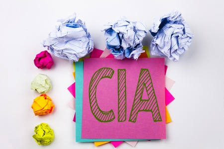 Writing text showing CIA  written on sticky note in office with screw paper balls. Business concept for Abbreviation on white isolated background.