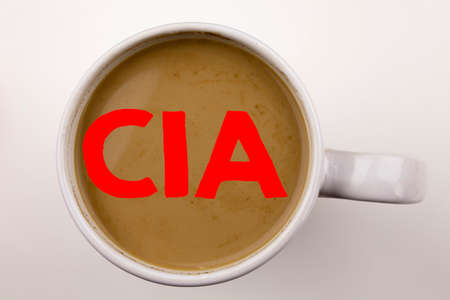 Word, writing CIA  text in coffee in cup. Business concept for Abbreviation on white background with space. Black text with red word. Stock Photo