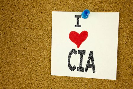 Hand writing text caption inspiration showing I Love CIA  concept meaning Abbreviation Loving written on sticky note, reminder isolated background with space Stock Photo