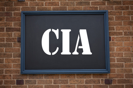Conceptual hand writing text caption inspiration showing announcement CIA . Business concept for  Abbreviation written on frame old brick background with space Stock Photo