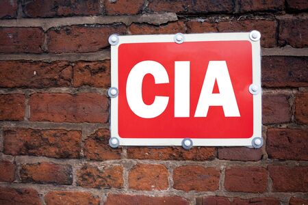 Hand writing text caption inspiration showing CIA  concept meaning Abbreviation written on old announcement road sign with background and space