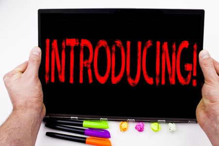 Introducing text written on tablet, computer in the office with marker, pen, stationery. Business concept for Introduction Start Intro Beginning white background with space