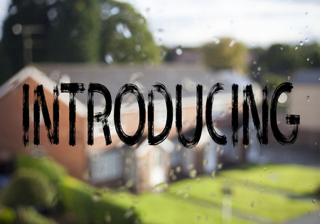 Announcement text caption showing Introducing. Business concept for Introduction Start Intro Beginning written on old brick background with space